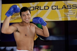 BANGKOK, THAILAND - SEPTEMBER 25: Jo-Wilfried Tsonga of France poses for the fans during a kickboxing demonstration on day three of the Thailand Open at Impact Arena on September 25, 2008 in Bangkok, Thailand. (Photo by Robert Cianflone/Getty Images)