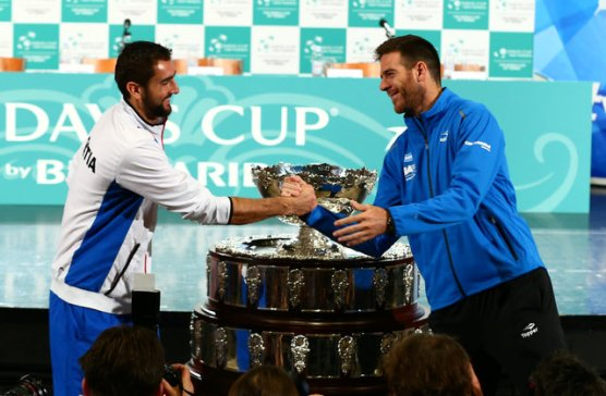 Croatia's tennis team player Marin Cilic and Argentina's tennis team player Juan Martin del Potro pose for a picture after the official draw for their Davis Cup finals in Zagreb