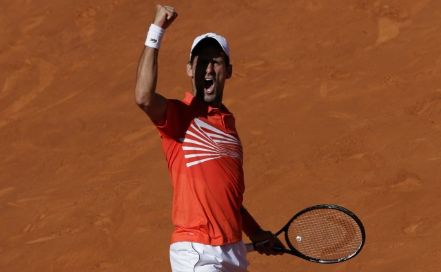 novak-djokovic-celebrates-beating-dominic-thiem-at-madrid-open-2019-images